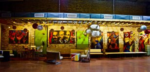 On a wall of Segundo Ruiz Belviz Cultural Center hangs the mural series painted in 1971 by Chicago artist and activist John Pitman Weber. The series depicts scenes from the civil rights movement. One painting portrays the Young Lords, a Puerto Rican nationalist group from Chicago. (Hannah Rank/MEDILL)