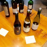 """A station at the Second City Sommelier's """"Sommelier Bootcamp"""" showcases wines made from Pinot Noir grapes grown in different areas of the world. (Kara Voght/MEDILL)"""