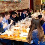 Sommeliers smell a white wine during blind tasting practice at City Winery. (Kara Voght/MEDILL)