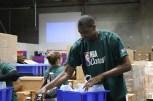 NBA Cares Ambassador Dikembe Mutombo working on the assembly line. (Athena Liu/MDEILL)