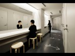 Women are seen in front of the shower rooms in Nine Hours, a chain capsule hotel.(Nacasa & Partners)