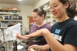 Malina Loeher demonstrates the strong suction ability of the abalone. (Rebecca Fanning/MEDILL)