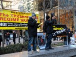 """Mark Masi, who started a chapter of Refuse Fascism in the northwest suburbs, reads from a speech he wrote for Saturday's protest. """"We, the people, must refuse to accept a fascist America."""""""