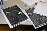 Organizers to repeal the ban on rent control prepared flyers in multiple languages. (Becky Dernbach / MEDILL)