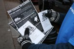 """Reggie Griffin holds flyers that urge people to vote """"yes"""" on the advisory rent control referendum. (Becky Dernbach / MEDILL)"""