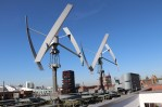 The headquarters of Greenpeace energy in Hamburg, Germany, utilize rooftop wind turbines. (Jillian Melero/Medill Reports)