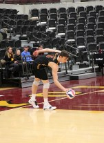 Loyola's Collin Mahan goes through his pre-serve dribble routine. Mahan notched two aces along with a team-high ten kills against UC San Diego on Saturday. (Tim Hackett//Medill)