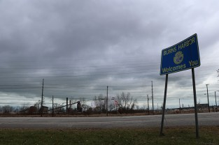 The welcome sign to Burns Harbor overlooks the ArcelorMittal steel mill. (Becky Dernbach/MEDILL)