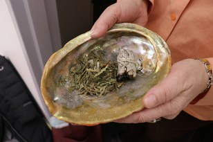 Sage, cedar or sweet grass is used to burn in the shell, a ceremony called Smudging that is practiced by many Native Americans to cleanse themselves with the smoke. (Lu Zhao/Medill)