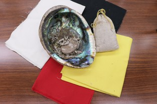 A bag of tobaccos (right) is used for prayer and a shell is for Smudging. The cloths of four colors represent four seasons, four directions or four characteristics in different Native cultures. (Lu Zhao/Medill)