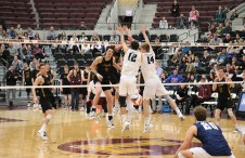 Loyola's Kyle Piekarski wraps an attack around Brett Wildman (12) in the third set. Piekarski finished with 12 kills for his fourth match this season with double-digit kills. (Tim Hackett//Medill)