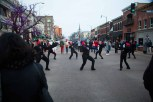 A dance troupe performs in the middle of the street. (Photo by Ankur Singh/Medill)
