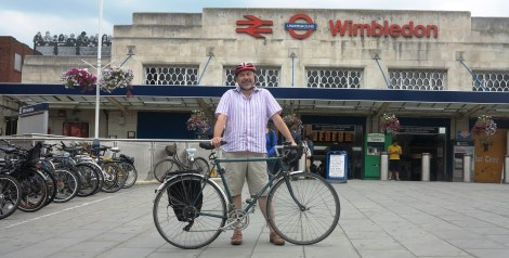 Cabinet member for environmental sustainability and regeneration Councillor Andrew Judge outside Wimbledon station