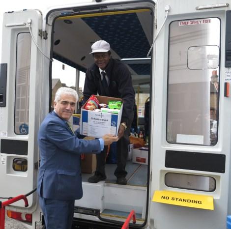 foodbank-donation-stephen-alambritis-and-vitalis-frederick