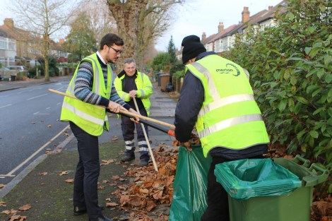 Cllr Ross Garrod out with the street sweeping team