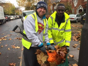 Robert and Kwaku, whco are part of the leaf sweeping team, our clearing the pavements of leaves