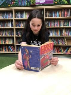 Emily reading Harry Potter