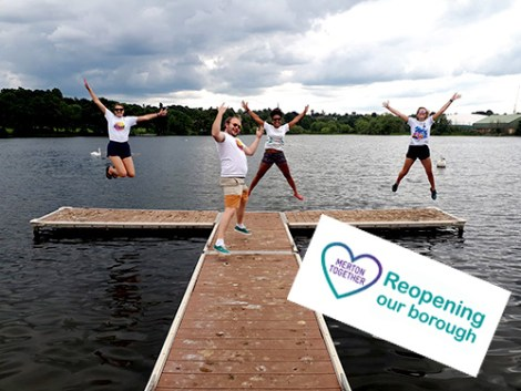 The staff at Wimbledon Watersports Center jumping for joy.