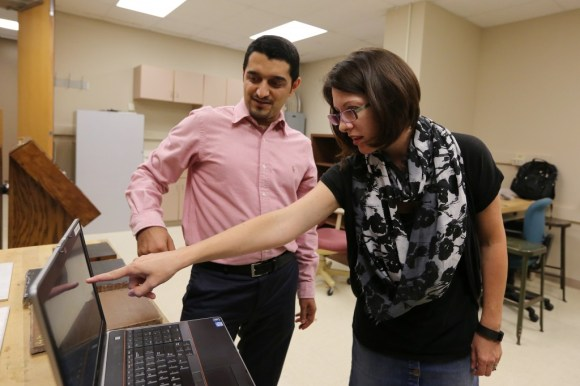 Professor Kristen Donnell, right, points to results of an active microwave thermography test that she and Ph.D. student Ali Foudazi run. Their work points out flaws within concrete or rehabilitated aluminum and could lead to increased safety for motorists and airline passengers.