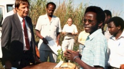 Robert Mwanga stands among a crowd of sweet potato growers.