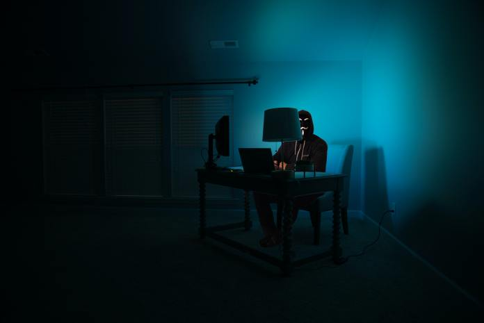 hacker sitting at a desk, ethical hacker