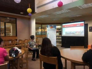 library staff showing resources on a screen to patrons