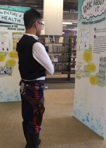 Man dressed as Han Solo looking at one the Graphic Mediicine displays