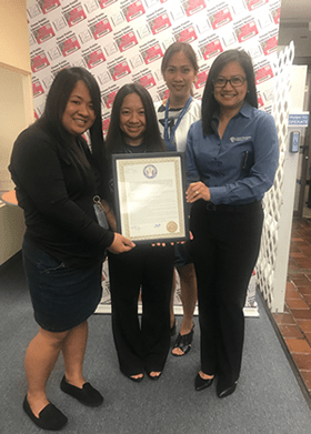 GRMC Patient Education Team showing their legislative resolution certificate