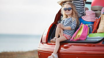 image_of_a_girl_sitting_in_a_car_on_holiday