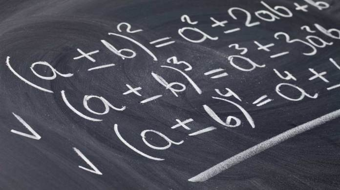 chalkboard with polynomial formulas sketched