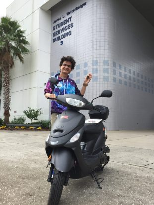 SF student with Solano Cycle scooter after winning bid