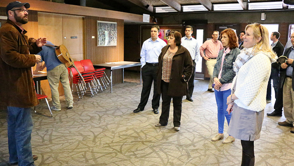 Faculty member Tony Doupe (left) speaks to a group of Shoreline City Council and city staff members, including City Manager  Debbie Tarry (center)  and Mayor Shari Winstead (right) during a tour of college theater and film facilities.