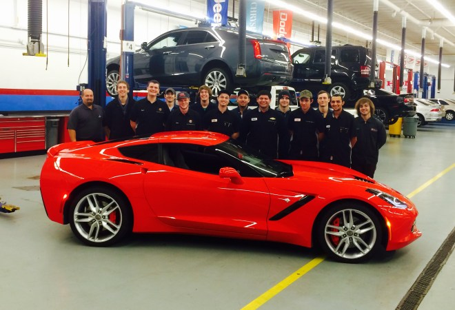 Shoreline Community College students pose with a 2014 Corvette Stingray that General Motors recently donated to the college's GM Automotive Service Educational Program (ASEP).