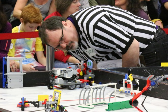 A judge examines an entry in the FIRST LEGO League competition held on Shoreline's campus in January of 2015.