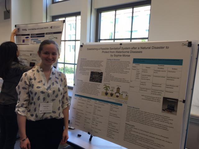 Shoreline Community College Sophie Morse stands next to her poster presentation.