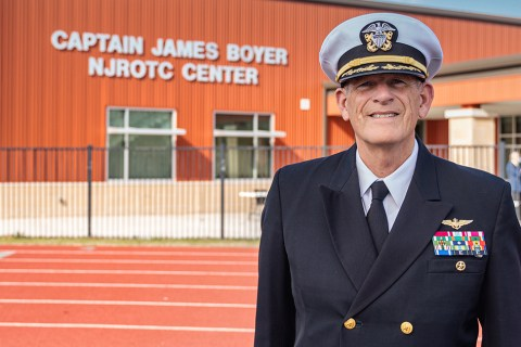 Retired U.S. Navy Capt. James Boyer, lead instructor of Spring High School's Navy JROTC program for almost two decades, stands in front of the new facility that bears his name.