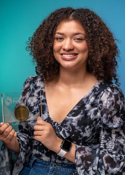 Spring High School 2021 graduate Zoë Taylor holds the Spring ISD Point of Pride award