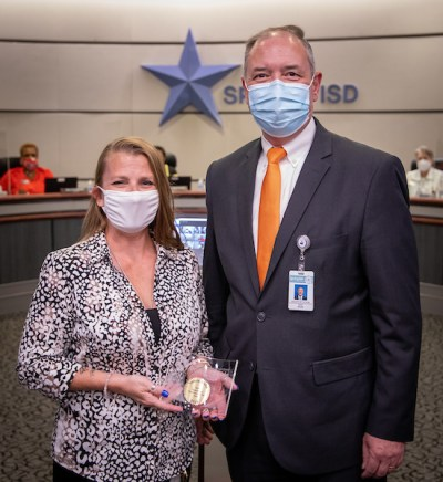 Spring ISD Routing Specialist Valerie Blaha, from left, with Director of Transportation Jack Mann, celebrating her Spring ISD Point of Pride Award for being named 2021 Operations Specialist of the Year by the Texas Association for Pupil Transportation