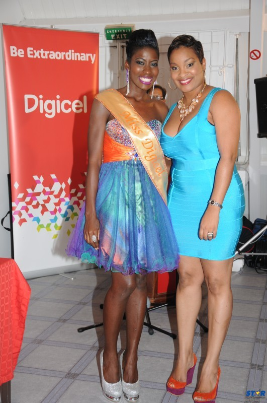 Digicel's Sergin John-Baptiste with Miss Digicel Michelle St Clair.