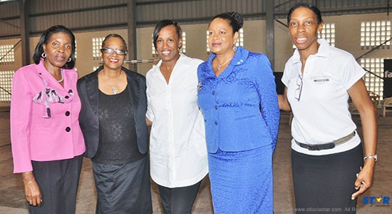 From left to right five of the prominent group of ladies at the Sport in Black & White Conference: Minister Emma Hippolyte, UNDP-Program Manager, Governance, Paula Mohamed; olympian Jackie Joyner-Kersee; Her Excellency Dr June Soomer and executive member of Sacred Sports Foundation, Nova Alexander.