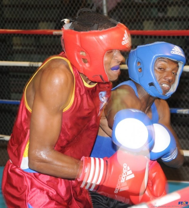 St Lucian Nyran David (l) and Cecil Hodge (Anguilla) exchanged some heavy blows.