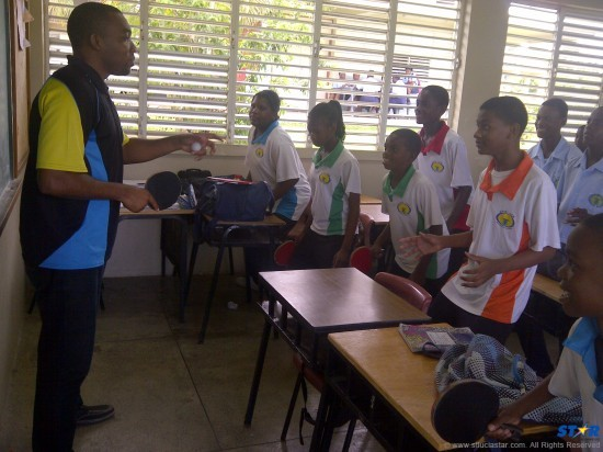 Anse Ger Secondary School students learn table tennis basics.