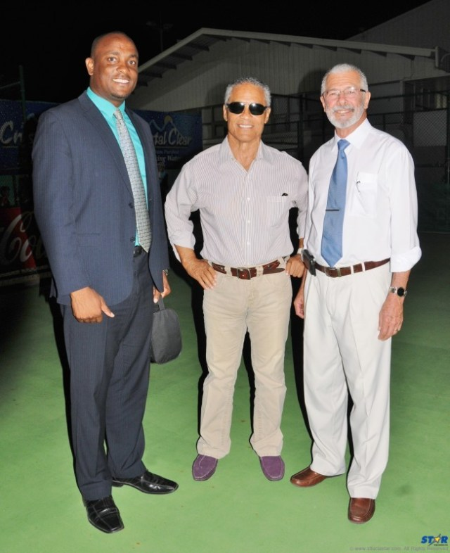 Rick Wayne (center) with Sports Minister Shawn Edward (l) and CEO of Duboulay's Bottling Company Limited Dunstan Duboulay.