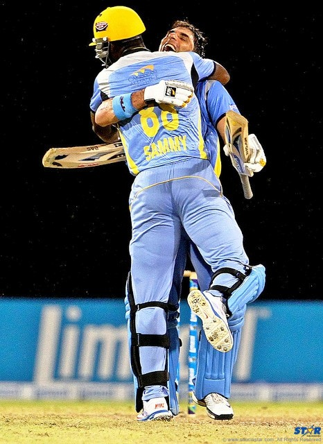 Zouks Captain Darren Sammy and Misbah-ul-Haq celebrate during play against Antigua Hawksbills.