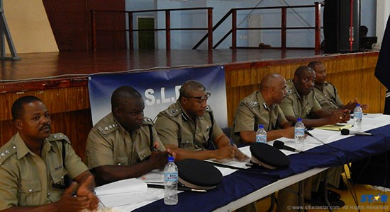 Police Commissioner Vernon Francois (fourth from left) with top cops at Tuesday's Gros-Islet town hall meeting.