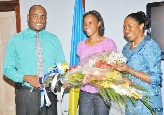 Levern Spencer (center) with Minister for Youth Development and Sports Shawn Edwards and Minister of Health and Gender Relations Alvina Reynolds.