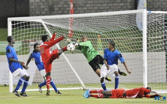The Roseau Valley goalkeeper (black shorts) and defenders (white shorts) kept Dennery from scoring during this wild scramble in Wednesday's game.