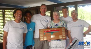 National J24 champions Jabal are presented with the Frank Capers Memorial Trophy by Mrs. Ginny Capers.