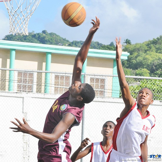Soufriere Comprehensive (l) and St Mary's College go after a rebound during Thursday's Under-15 basketball final.