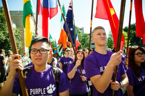 To end the procession, international students carry flags representing their countries of origin. (Photo by Mark Brown)